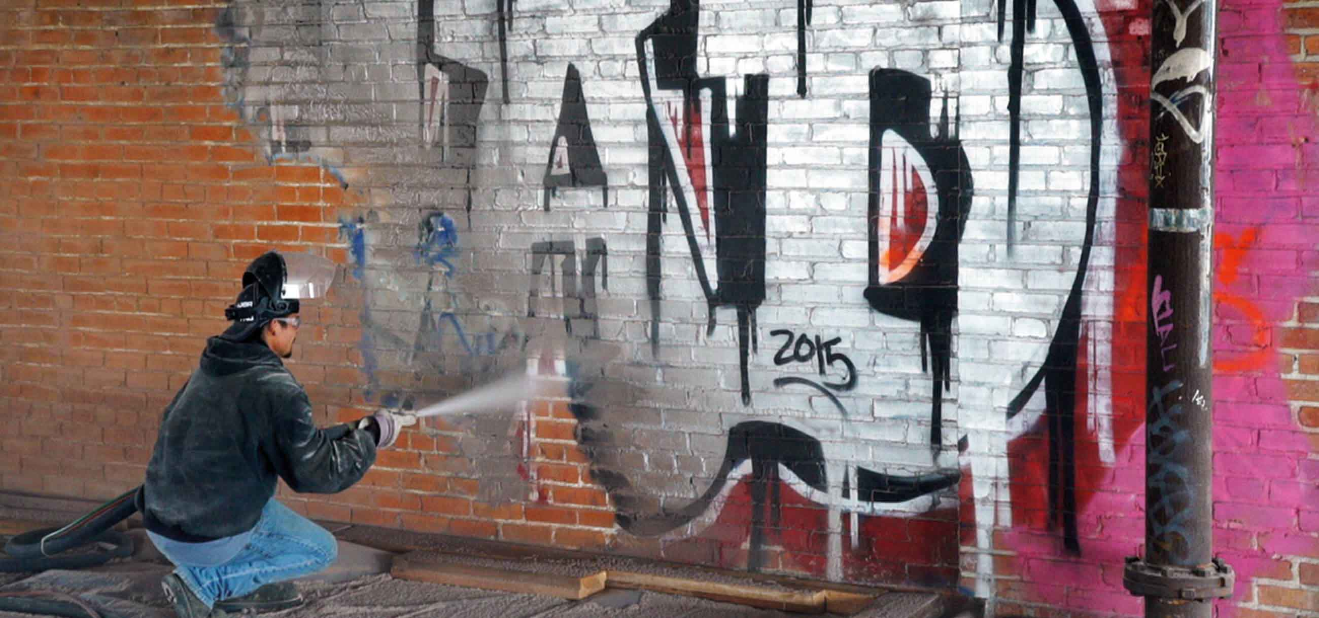 removing graffiti from brick wall