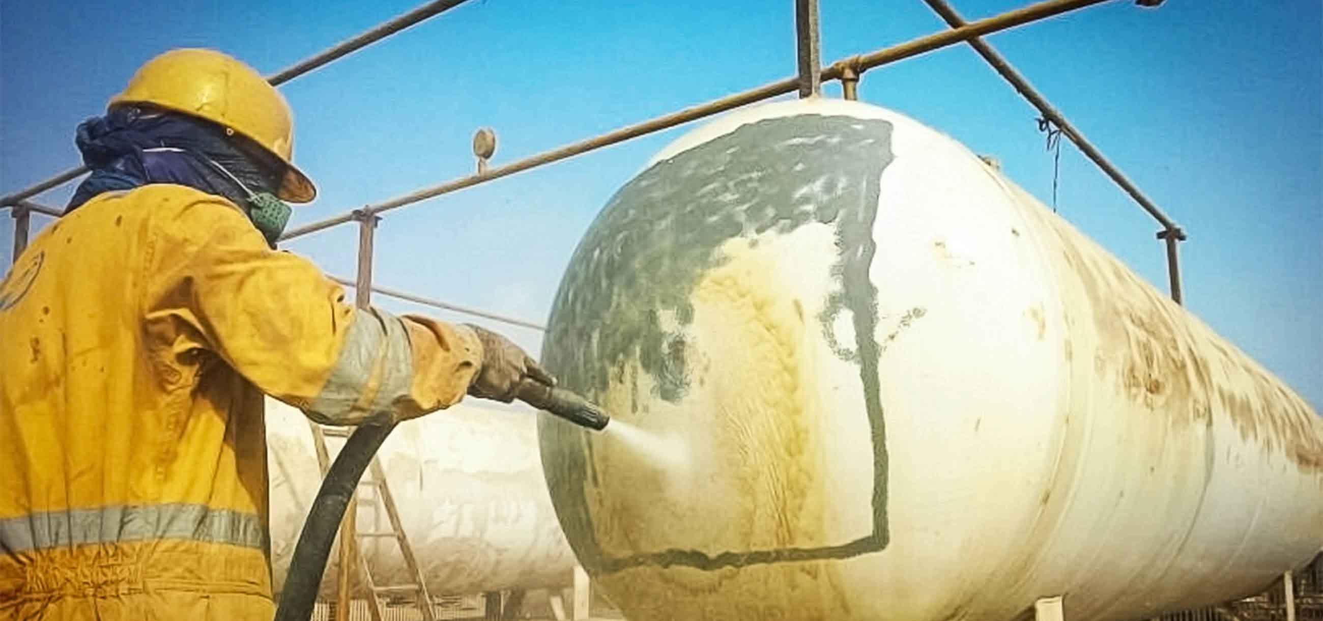blasting large industrial tank