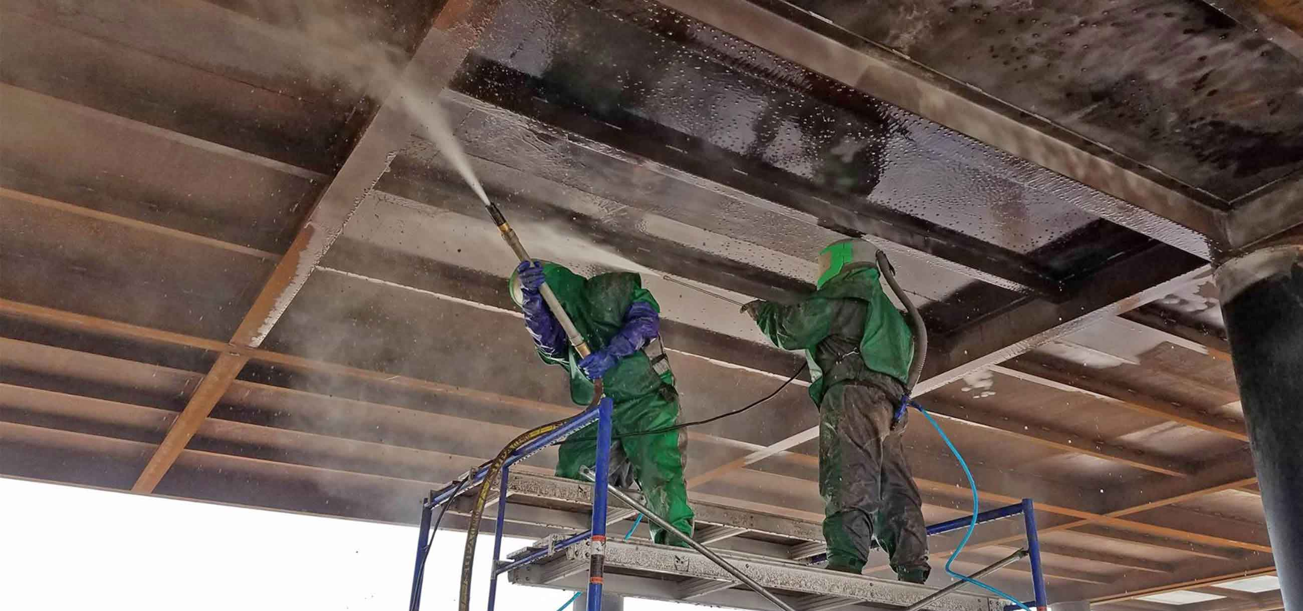 blasting ceiling in protective suits