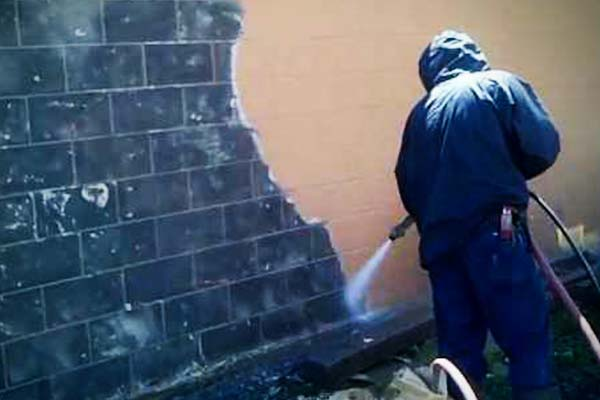 removing yellow paint from cinderblock wall
