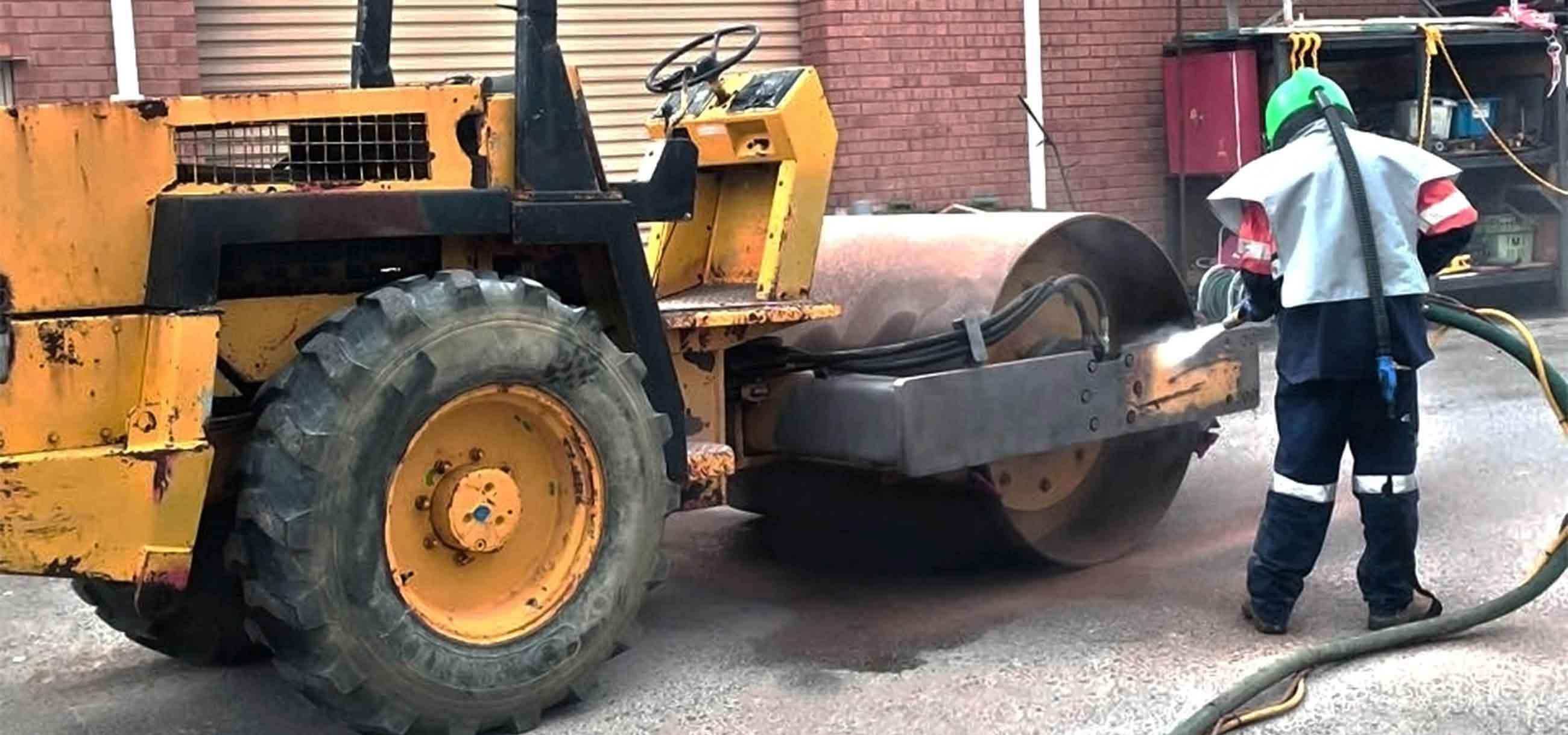 blasting paint off cement roller equipment