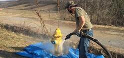 blasting paint from yellow fire hydrant