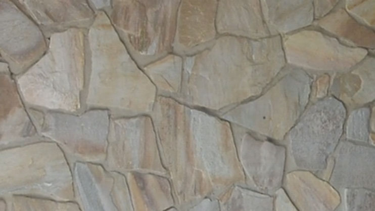 Natural stone wall after latex paint removal