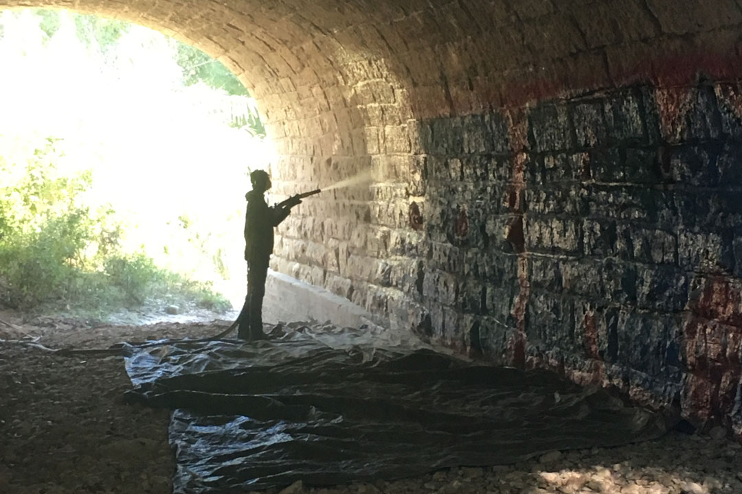 graffiti cleaning from underside of a stone bridge