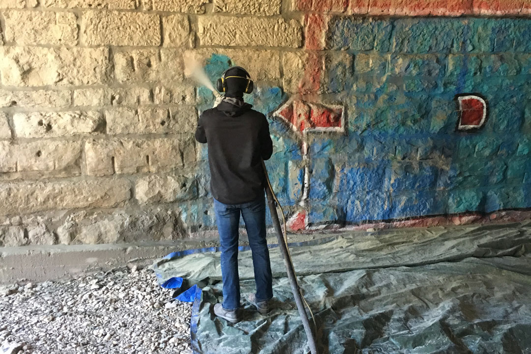 texas green blast removing graffiti from stone