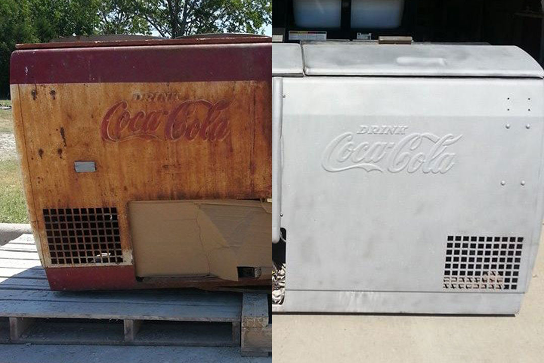 old rusty coca cola cooler restored