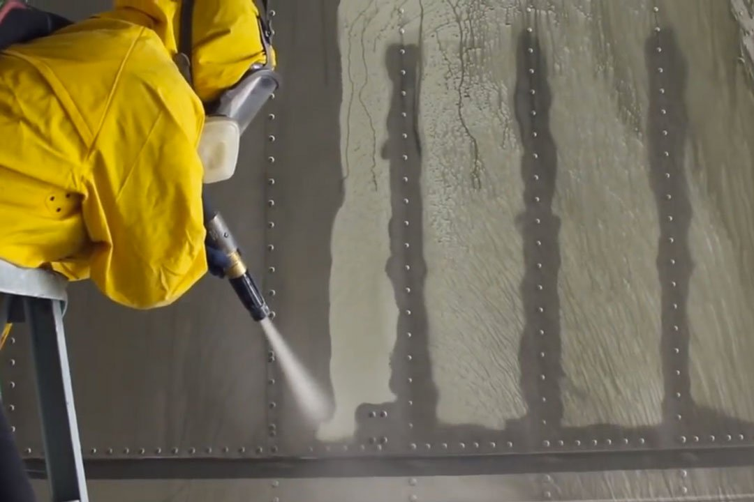 sandblasting rivets on a semi trailer