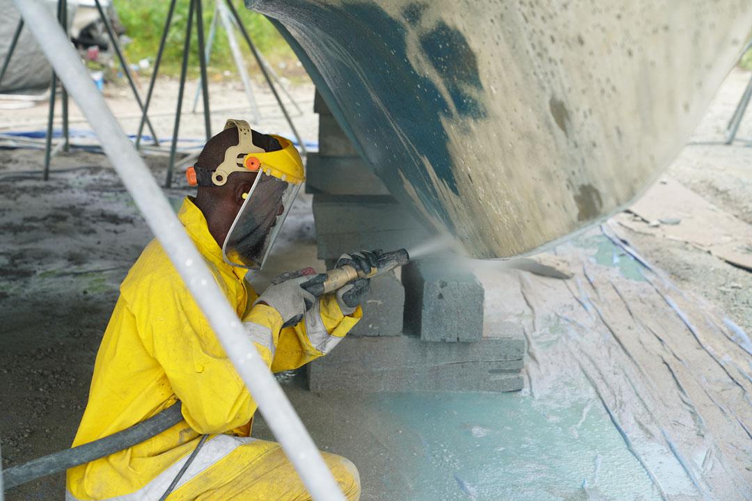abrasive blasting a catamaran hull