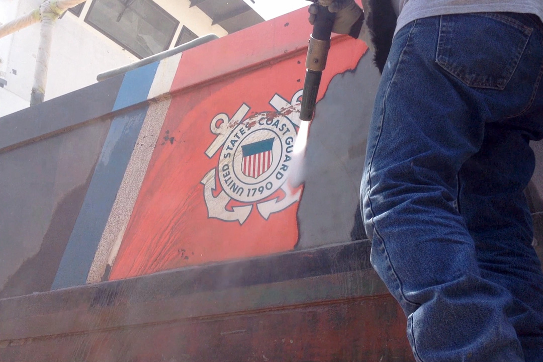 abrasive blasting a coast guard boat