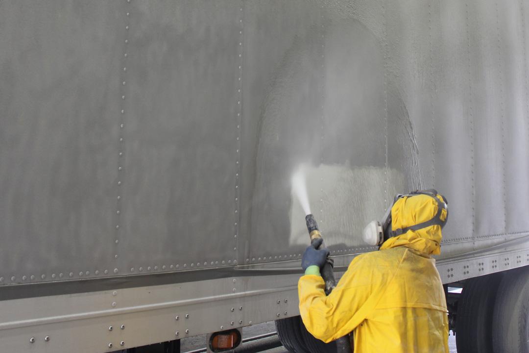 abrasive blasting a fleet trailer