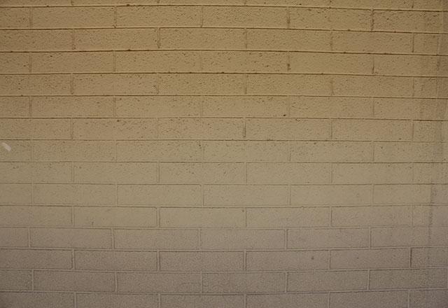 brick wall before asbestos abatement