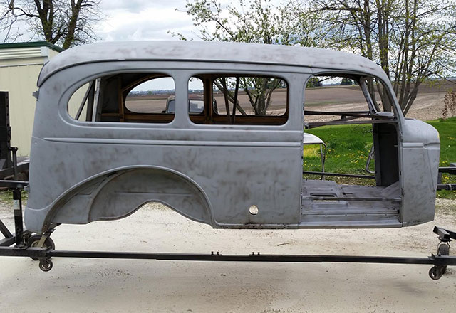 Classic auto body stripped after