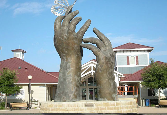 hands statue cleaned before