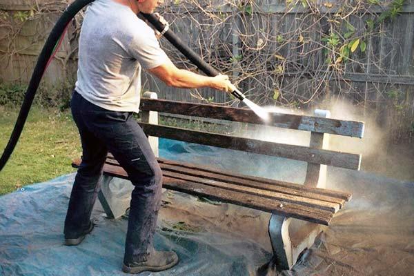 dustless blasting a wooden bench