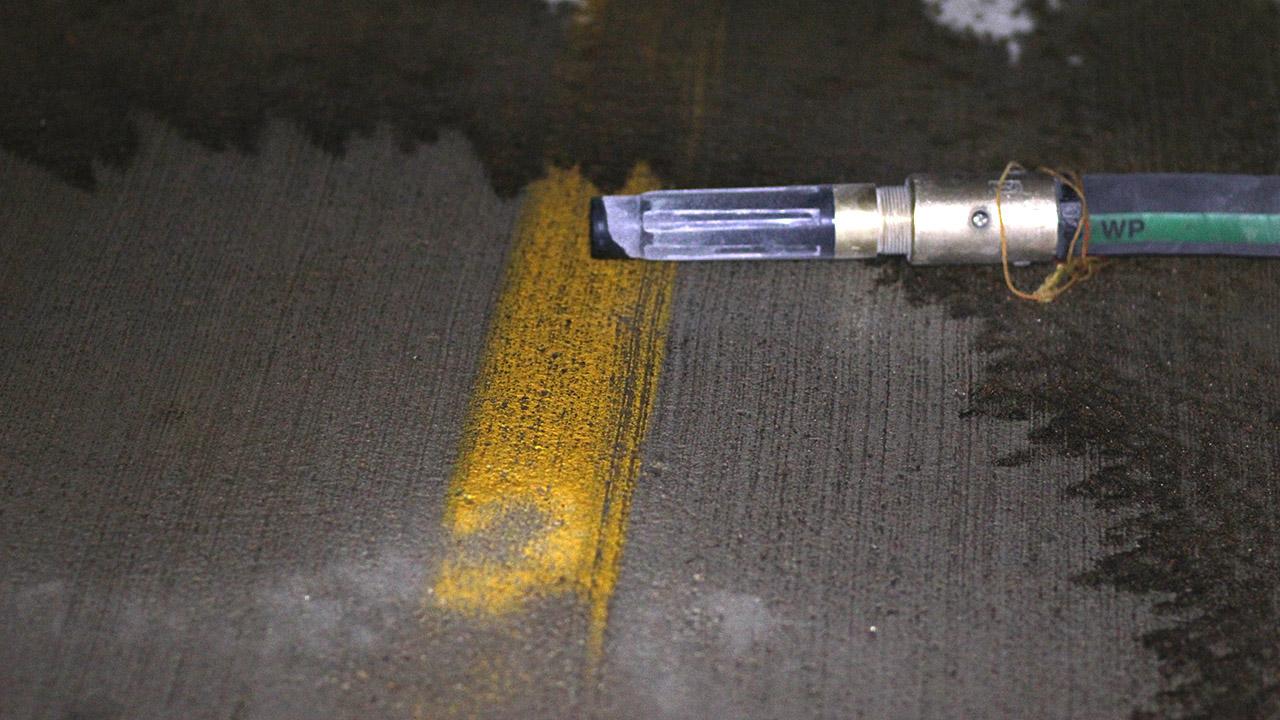 Dustless Blasting for Line Stripe Removal