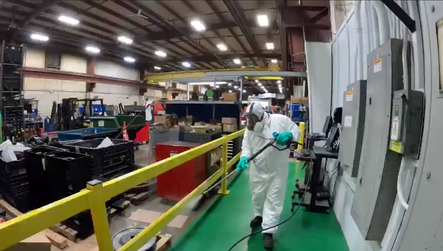 spraying disinfectant inside manufacturing facility