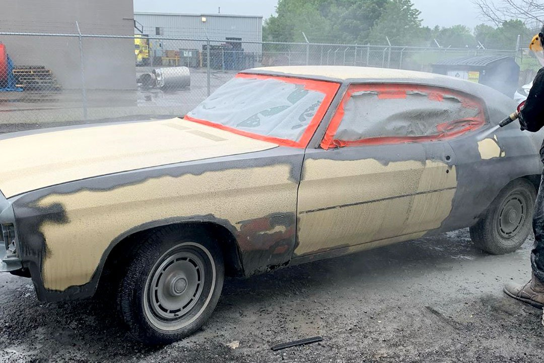 sandblasting a car for restoration